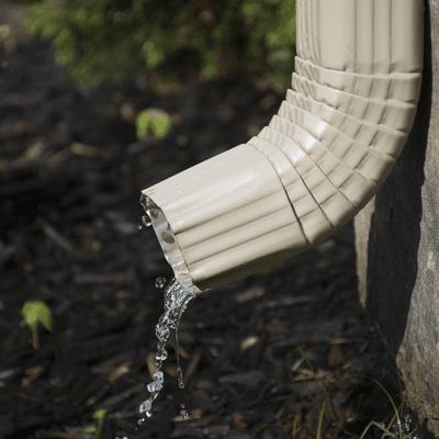 gutter draining in flower bed